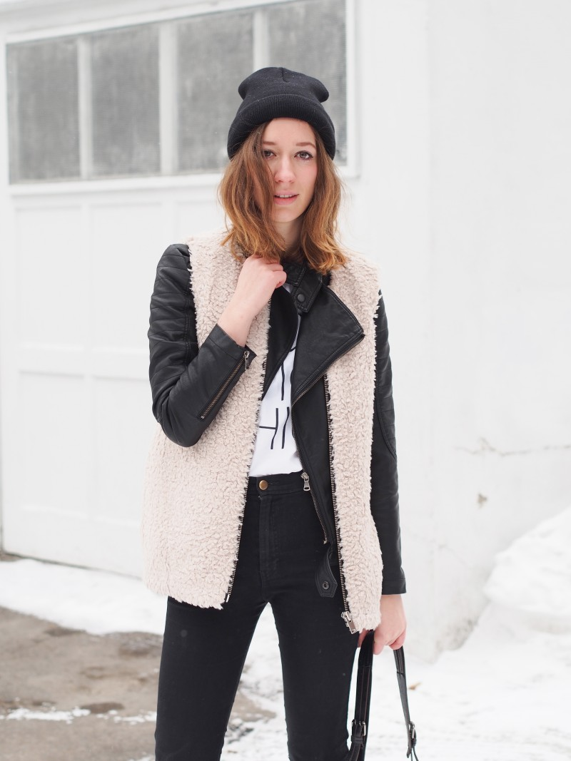 Aritzia wool vest layered over leather