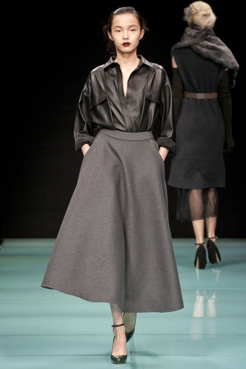 gray skirt with leather shirt on runway