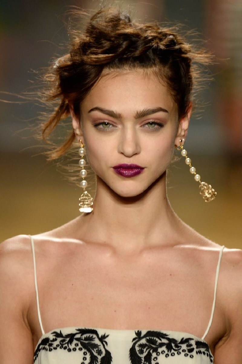 purple lips on the runway