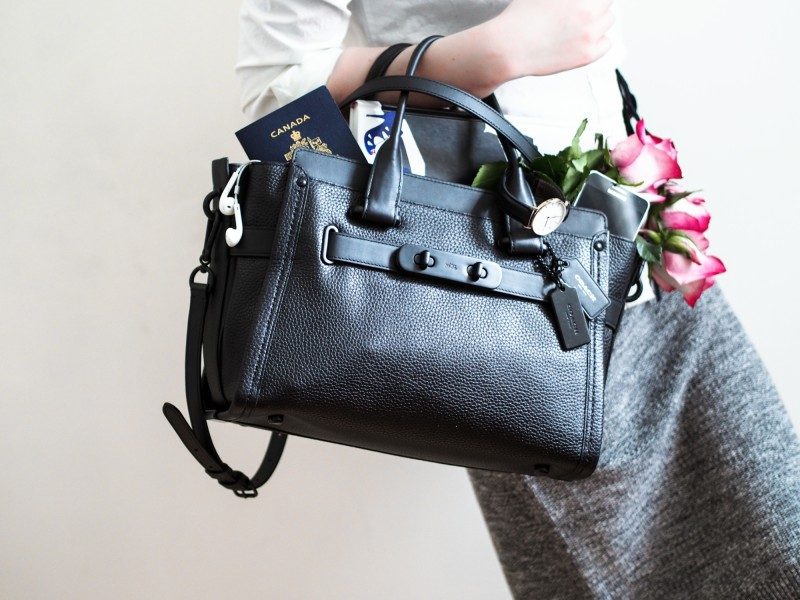 Montreal fashion blogger Dentelle+Fleurs with Coach swagger bag