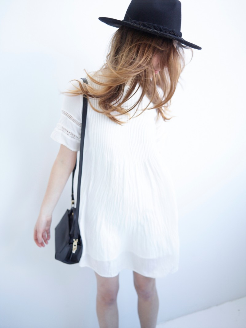 white aritzia dress and bega bag for spring