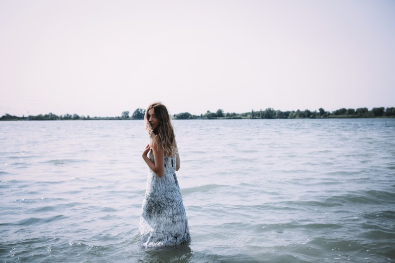 canadian fashion blogger in marble dress in water