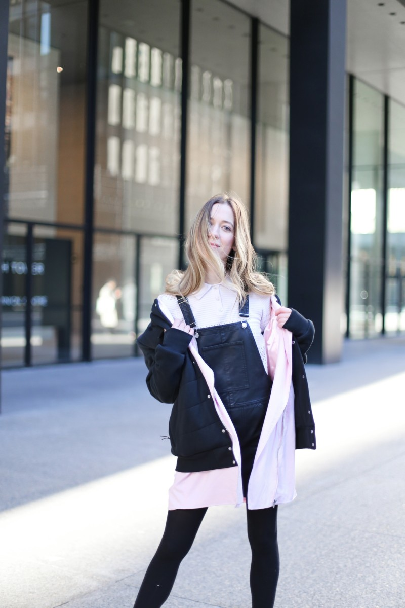 leather overall and layered pink outfit